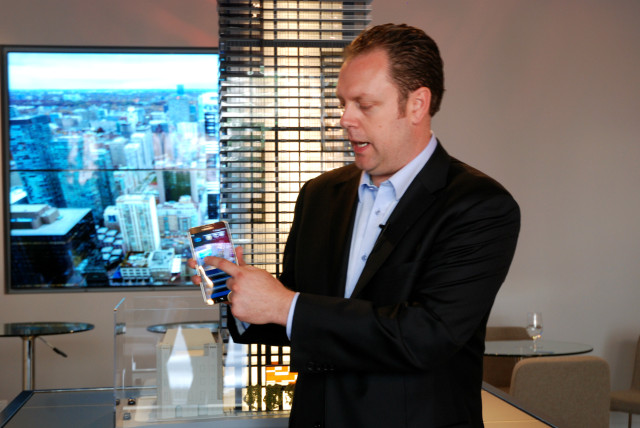 True Marque Managing Director Jason Abbott demonstrating smart features at the YC Condos presentation centre